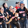 WARREN DILLAWAY / Star Beacon<br /> KAYCEE FUSCO (11) and Jefferson teammates Taylor Johnston (12), Nicole Hamski (center middle) and Emily Smock (1) celebrate after defeating Notre Dame Cathedral Latin in a Division II district semifinal at the Jefferson Area Girls Softball Complex.