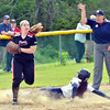WARREN DILLAWAY / Star Beacon<br /> ALYSSA CHADWICK of Conneaut is out at third on Thursday during a Division II district semifinal  at the Jefferson Area Girls Softball Complex. Jenny Mettler of Perry made the putout for the Pirates.