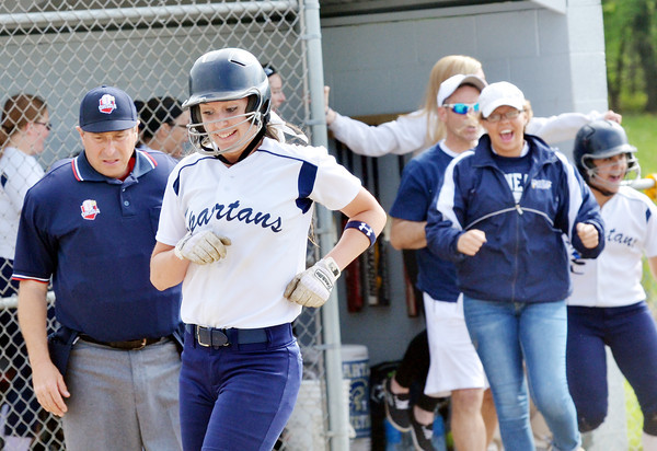 WARREN DILLAWAY / Star Beacon<br /> LEXI ZAPPITELLI of Conneautwas all smiles as she scored a run on Thursday during a Division II district semifinal  at the Jefferson Area Girls Softball Complex.