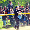 WARREN DILLAWAY / Star Beacon<br /> DON MCCORMACK, Jefferson girls softball coach, gestures to a runner on Thursday during a Division II district semifinal game at the Jefferson Area Girls Softball Complex.
