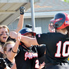 WARREN DILLAWAY / Star Beacon<br /> SAM HAMSKI (10) is congratulated by Jefferson teammates Carley Truckey (2) and Tayler Johnston (far left) on Thursday during a Division II district semifinal at the Jefferson Area Girls Softball Complex.