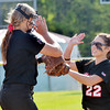 WARREN DILLAWAY / Star Beacon<br /> DEANNA COMP of Jefferson (right) congratulates pitcher Alyssa Iron after an out on Thursday during a Division II district semifinal with Notre Dame Cathedral Latin at the Jefferson Area Girls Softball Complex.
