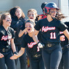 WARREN DILLAWAY / Star Beacon<br /> KAYCEE FUSCO (11) and Jefferson teammates Taylor Johnston (left), and Emily Smock (1) celebrate after defeating Notre Dame Cathedral Latin in a Division II district semifinal at the Jefferson Area Girls Softball Complex.