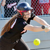 WARREN DILLAWAY / Star Beacon<br /> BAILEY BECKWITH of Jefferson lays down a bunt on Thursday during a Division II district semifinal with Notre Dame Cathedral Latin at the Jefferson Area Girls Softball Complex.