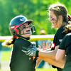 WARREN DILLAWAY / Star Beacon<br /> SAM HAMSKI (left) of Jefferson is congratulated by teammate McKenzie Wilber after Hamski knocked in the only run of the game during a Division II district semifinal game at the Jefferson Area Girls Softball Complex.