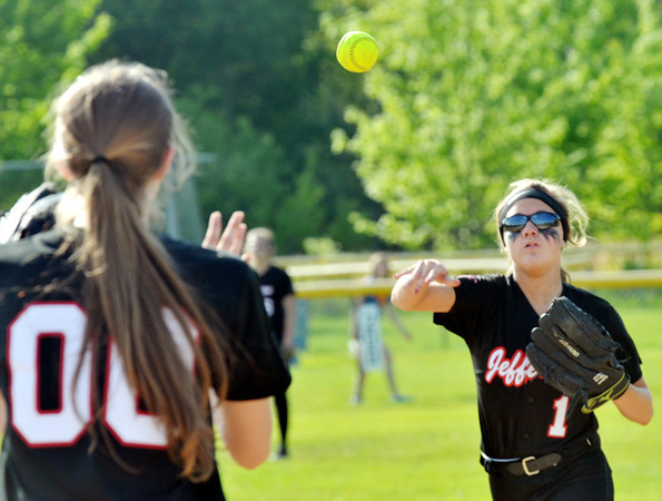 WARREN DILLAWAY / Star Beacon<br /> EMILY SMOCK (1) throws to teammate Bailey Beckwith for a put out on Thursday during a Division II district semifinal game at the Jefferson Area Girls Softball Complex.