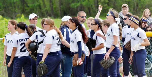 WARREN DILLAWAY / Star Beacon<br /> NICK ARMENI of Conneaut (with sunglasses) gathers his team between innings on Thursday during a Division II district semifinal  at the Jefferson Area Girls Softball Complex.