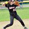 WARREN DILLAWAY / Star Beacon<br /> DEANNA COMP of Jefferson prepares to throw to first on Thursday during a Division II district semifinal with Notre Dame Cathedral Latin at the Jefferson Area Girls Softball Complex.