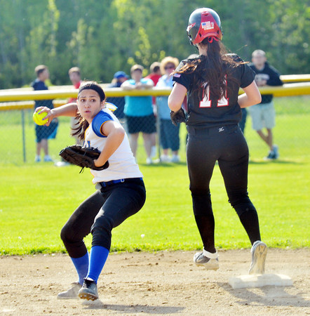 WARREN DILLAWAY / Star Beacon<br /> BAILEY BECKWITH of Jefferson (11) is forced at second base while Camille Pollutro, Notre Dame Cathedral Latin shortssssstop, tries to turn a doouble play on Thursday during a Division II district semifinal with Notre Dame Cathedral Latin at the Jefferson Area Girls Softball Complex.