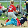 WARREN DILLAWAY / Star Beacon<br /> BELLA ANTHONY of Conneaut slides safely home as Claire Randolph of Kingsville waits for the ball during Minor League action on Tuesday night at Skippon Park.