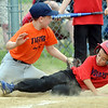WARREN DILLAWAY / Star Beacon<br /> ALBERT ORTIZ of the Indians slides safely under the tag of Zach Rice of the Tigers on Tuesday evening during Minoor league action at Skippon Park.