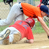WARREN DILLAWAY / Star Beacon<br /> PATRICK KANTOLA of the Indians slides home safely as Zach Rice of the Tigers tries to keep his balance during Conneaut Minor League action on Tuesday evening at Skippon Park.