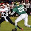 WARREN DILLAWAY / Star Beacon<br /> PATRICK SULLIVAN, Chardon quarterback (12) tries to      elude Antonio Harris (20) of Lakeside on Friday night in Saybrook Township.