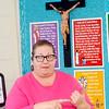 WARREN DILLAWAY / Star Beacon<br /> ANGELA ACKLEY teaches a seventh grade English class at St. John School in Saybrook Township.