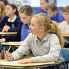 WARREN DILLAWAY / Star Beacon<br /> KATIE KOVACH listens during a sixth grade math class at St. John School in Saybrook Township.
