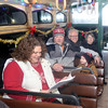 WARREN DILLAWAY / Star Beacon<br /> VISITORS PREPARE for a ride on the Jolly Trolley for a trip to Lights on the Lake on Friday evening in Ashtabula. (From left) Sheri, Jerry and Colin, 3, Caster of Cleveland and Chris and Carolyn Tenney of Geneva.