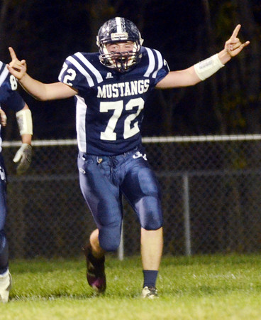 WARREN DILLAWAY / Star Beacon<br /> AUSTIN EUBANK of Grand Valley celebrates after a Mustang touchdown on Friday night during a home game with Ledgemont.
