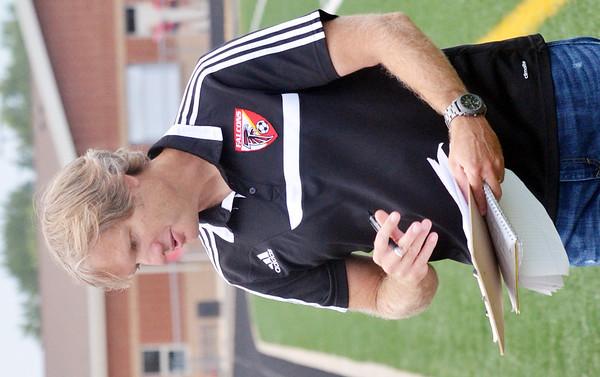 WARREN DILLAWAY / Star Beacon<br /> BILL MCMINN, Jefferson soccer coach, talks to his team before a home match with Girard.