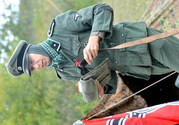 WARREN DILLAWAY / Star Beacon<br /> BRIAN LEMONOVICH of Cleveland prepares for a battle during a World War II re-enactment at Walnut Beach in Ashtabula. Lemonovich is a German soldier re-enactor.