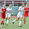 WARREN DILLAWAY / Star Beacon<br /> BRITTANY AVENI (second from right) brought a smile to the face of Geneva teammate Summer Arndt (4) after scoring a goal against Parma. Brooke Guthrie (3) and Emily Martch (2)  follow the play.