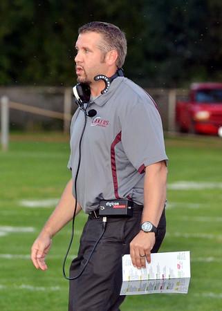 WARREN DILLAWAY / Star Beacon<br /> NEAL CROSTON, Pymatuning Valley football coach, encourages his team on Friday night at Edgewood.