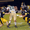 WARREN DILLAWAY / star Beacon<br /> ANTONIO HARRIS (20) of Lakeside tries to elude Riverside defenders including Steven Ettinger (21) and Dustin Ettinger (41) on Friday night in Painesville Township.