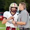 WARREN DILLAWAY / Star Beacon<br /> NEAL CROSTON, Pymatuning Valley football coach, talks to quarterback Mitchell Skleres on Friday night at Edgewood.