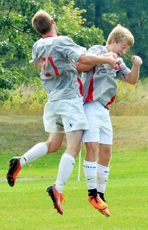 WARREN DILLAWAY / Star Beacon<br /> ADAM HEFFNER (21) celebrates with Edgewood teammate James Kulko on Saturday  during a home match with Geneva.