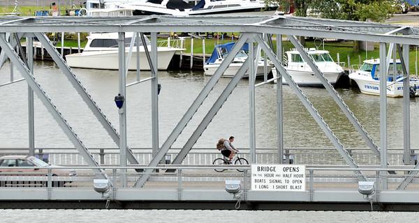 WARREN DILLAWAY / Star Beacon<br /> A LONE cyclist rides across the Ashtabula Lift Bridge on Monday.