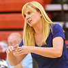 WARREN DILLAWAY / Star Beacon<br /> STEPHANIE KUBEC, St. John volleyball coach, watches the action on Tuesday evening at Jefferson.