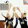 WARREN DILLAWAY / Star Beacon<br /> BAILEY BECKWITH (00) and Jefferson teammate Hayley Allen (99) attempt to block a spike by a St. John player on Tuesday night at Jefferson.