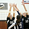 WARREN DILLAWAY / Star Beacon<br /> BAILEY BECKWITH (00) and Jefferson teammate Emily DeGeorge attempt to block a spike by Mallory Shellenberger (17) of St. John on Tuesday night at Jefferson.