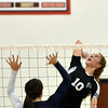 WARREN DILLAWAY / Star Beacon<br /> EMILY DEGEORGE (10) of Jefferson prepares to spike the ball over  Mallory Shellenberger of St. John on Tuesday evening at Jefferson.