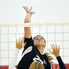 WARREN DILLAWAY / Star Beacon<br /> ALYSSA IRONS (27) of Jefferson prepares to spike the ball over a St. John player on Tuesday evening at Jefferson.