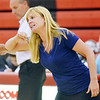 WARREN DILLAWAY / Star Beacon<br /> STEPHANIE KUBEC, St. John volleyball coach, instructs her team on Tuesday evening at Jefferson.
