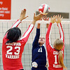 WARREN DILLAWAY / Star Beacon<br /> ALICIA NGIRAINGAS (11) of St. John tries to get the ball by Edgewood defenders Iesha Niciu (23) and Taylor Hawkins (10) onn Monday evening at Edgewood.