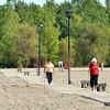 WARREN DILLAWAY / Star Beacon<br /> WALKERS ENJOY a sunny Monday morning at Conneaut Township Park boardwalk.