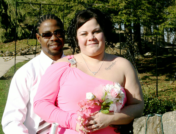"""MARGIE NETZEL / Star Beacon<br /> THE BRIDE WORE pink as Reginald Steele and Ashley Daubenspeck as they said """"I do"""" on 12/12/12 at noon at Lake Shore Park. The ceremony was performed by Sharon Bradley of Weddings With Your View."""