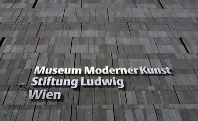 Sign of MUMOK (Museum Moderner Kunst or Museum of Modern Art) on Basalt-lava Stone Facade, MuseumsQuartier in Vienna (Wien), Austria
