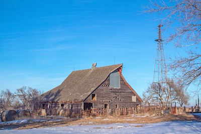 Old barn and windmill in South Dakota. Although the homestead is abandoned, I am not sure that the barn is still being used.