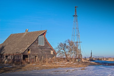 Abandoned barn and windmill in South Dakota. Enjoy and hold hands.