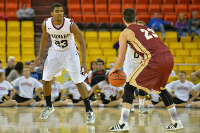 November 28, 2013: Harvard Crimson guard/forward Wesley Saunders (23) plays defense against  Denver Pioneers guard Brett Olson (23) in a first round game at the 2013 Great Alaska Shootout between Harvard and Denver.  Harvard defeated Denver 68-60. Harvard defeated Denver 68-60.