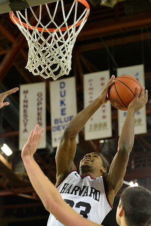 November 28, 2013: Harvard Crimson guard/forward Wesley Saunders (23) goes up for a layup in a first round game at the 2013 Great Alaska Shootout between Harvard and Denver.  Harvard defeated Denver 68-60. Harvard defeated Denver 68-60.