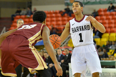 November 28, 2013: Harvard Crimson guard Siyani Chambers (1) surveys the defense in a first round game at the 2013 Great Alaska Shootout between Harvard and Denver.  Harvard defeated Denver 68-60. Harvard defeated Denver 68-60.