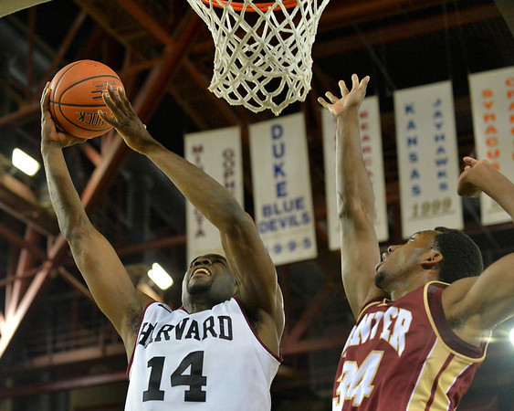 November 28, 2013: Harvard Crimson forward Steve Moundou-Missi (14) puts up a layup against Denver Pioneers forward Chris Udofia (34) in a first round game at the 2013 Great Alaska Shootout between Harvard and Denver.  Harvard defeated Denver 68-60. Harvard defeated Denver 68-60.