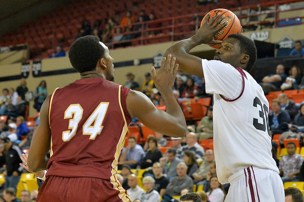 November 28, 2013: Harvard Crimson forward Kyle Casey (30) looks to pass the ball to a teammate in a first round game at the 2013 Great Alaska Shootout between Harvard and Denver.  Harvard defeated Denver 68-60. Harvard defeated Denver 68-60.
