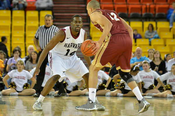 November 28, 2013: Harvard Crimson forward Steve Moundou-Missi (14) plays defense in a first round game at the 2013 Great Alaska Shootout between Harvard and Denver.  Harvard defeated Denver 68-60. Harvard defeated Denver 68-60.