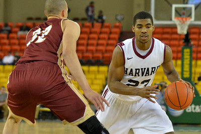 November 28, 2013: Harvard Crimson guard/forward Wesley Saunders (23) drives past Denver Pioneers forward Drick Bernstine (32) in a first round game at the 2013 Great Alaska Shootout between Harvard and Denver.  Harvard defeated Denver 68-60. Harvard defeated Denver 68-60.