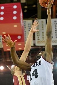 November 28, 2013: Harvard Crimson forward Steve Moundou-Missi (14) shoots over a Denver Pioneers defender in a first round game at the 2013 Great Alaska Shootout between Harvard and Denver.  Harvard defeated Denver 68-60. Harvard defeated Denver 68-60.