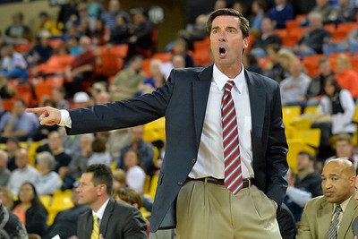 November 28, 2013: Denver Pioneers head coach Joe Scott yells at an official in a first round game at the 2013 Great Alaska Shootout between Harvard and Denver.  Harvard defeated Denver 68-60. Harvard defeated Denver 68-60.